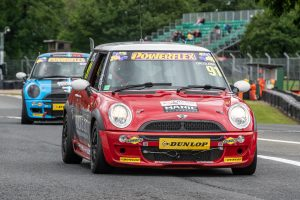 Robbie Dalgleish racing in Mini Challenge at Oulton Park